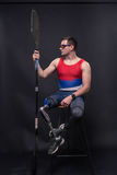 Man athlete sporstman canoe kayak paddle, prosthetic leg. One young adult man only, sitting in bar stool, athlete sporstman canoe kayak paddle, prosthetic leg Royalty Free Stock Images