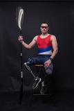Man athlete sporstman canoe kayak paddle, prosthetic leg. One young adult man only, sitting in bar stool, athlete sporstman canoe kayak paddle, prosthetic leg Royalty Free Stock Photography