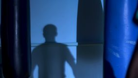 Man athlete standing and doing shadow boxing exercises in gym. Boxer doing a shadow fight stock footage