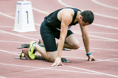 Man athlete in starting position Royalty Free Stock Images