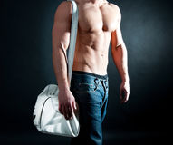 Man with athletic body holding a bag stock photos