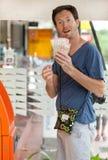 Man at ATM. Young caucasian man withdrawing money at ATM Royalty Free Stock Photos
