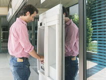 Man atm cash withdraw. Man on atm getting cash Royalty Free Stock Image