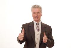 Man att göra en gest tum som isoleras upp på white Arkivbild
