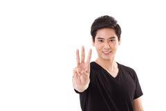 Man att lyfta som visar för handtecken för 3 fingrar gest Royaltyfria Bilder