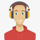 Man att lyssna till musik till och med hörlurar Royaltyfria Foton
