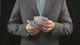 Man att räkna pengar, affärsstarten, inkomst, vinst, intresse arkivfilmer