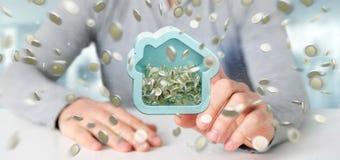 Man att rymma en husmoneybox med myntet som över hela omger 3d r Fotografering för Bildbyråer