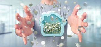 Man att rymma en husmoneybox med myntet som över hela omger 3d r Royaltyfri Bild