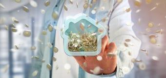 Man att rymma en husmoneybox med myntet som över hela omger 3d r Royaltyfri Foto