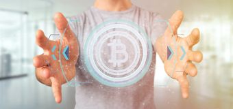 Man att rymma en teknologiBitcoin symbol på en tolkning för cirkel 3d Arkivfoto