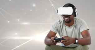 man att spela med dataspelkontrollanten med ljusa ljusa anslutningar i bakgrund Royaltyfria Bilder