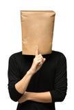 man att täcka hans huvud genom att använda en pappers- påse quiet royaltyfri fotografi