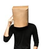 man att täcka hans huvud genom att använda en pappers- påse tänka för man Arkivbild