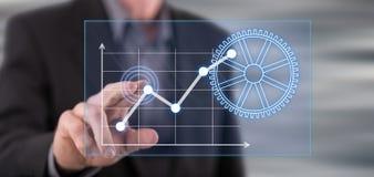 Man att trycka på ett digitalt begrepp för affärsanalys på en pekskärm fotografering för bildbyråer
