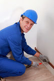 Man attaching copper pipe Royalty Free Stock Image