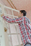 Man attaching door panel Royalty Free Stock Photo
