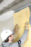 Man attaching insulation to wall stock photo