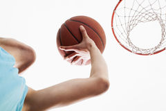 Man attempting to through basketball in to the basket Royalty Free Stock Photos