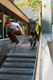 Man Attempts Difficult Skateboard Trick While Being Filmed Royalty Free Stock Photos