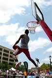 Man Attempts Reverse Jam In Outdoor Slam Dunk Competition Stock Image