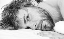 Man attractive macho relax and feel comfortable. Man unshaven bearded face sleep relax or just wake up. Simple tips to stock images