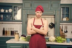 Man attractive nude chef wear apron and hat. Sexy muscular chef in front of kitchen. Attractive chef ready to cook. Muscular chef posing in kitchen. Cook royalty free stock image
