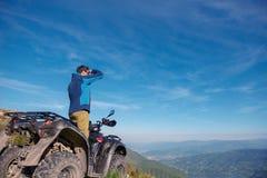 Man on the ATV Quad Bike on the mountains road. Man on the ATV Quad Bike on the mountains road Royalty Free Stock Photos