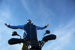 Man on the ATV Quad Bike on the mountains road. Royalty Free Stock Images