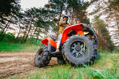 Man on the ATV Quad Bike running in mud track Royalty Free Stock Image