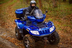 Man on ATV. Stock Photo