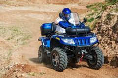 Man on ATV. A man is riding the ATV on the sand Royalty Free Stock Photo