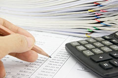 Man is auditing account with pencil and calculator Royalty Free Stock Photo