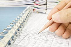 Man is auditing account by pencil with notebook Stock Photos