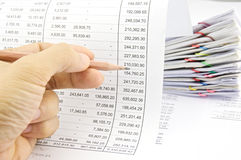 Man auditing account by pencil with pile of paperwork Stock Images