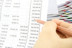 Man auditing account by pencil with pile of report Stock Photography