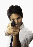 Man with automatic pistol. Young asian man with automatic pistol aiming right at you Royalty Free Stock Photography