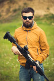 A man with an automatic rifle. Outdoor Royalty Free Stock Image