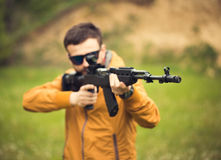 A man with an automatic rifle. Outdoor Stock Photography