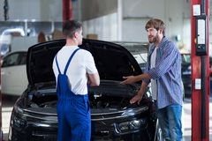 Man at automobile repair shop Stock Image