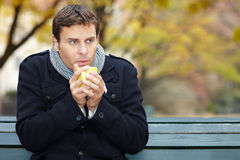 Man in autumn drinks tea Stock Photography