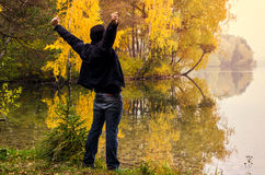 Man by autumn lake Royalty Free Stock Images