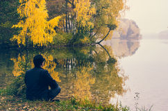 Man by autumn lake Stock Photography