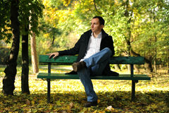Man in autumn park Stock Photo