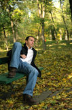 Man in autumn park Royalty Free Stock Photo