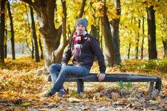 Man in autumn park Stock Photos