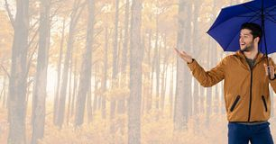 Man in Autumn with umbrella in bright forest Royalty Free Stock Images