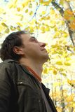 Man in the autumn woods Royalty Free Stock Images