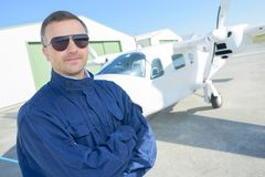 Man in aviator glasses by aircraft. Man Stock Images
