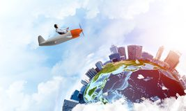 Man in aviator hat with goggles driving plane royalty free stock images